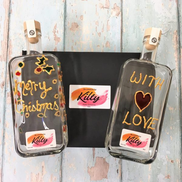 two creative Kilty Gin bottles